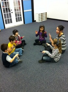 Students practice steady beat with Ms. Tamara.